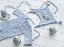 Knitted handmade clothes for infant boys, topview stock photos