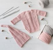 Knitted handmade clothes for infant girls, topview stock images