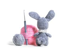 Knitted hare amigurumi. With tangles of thread Royalty Free Stock Photos