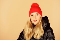 Free Knitted Hat. Bright Detail. Pretty Girl Enjoy Wearing Warm Jacket. Warm Coat. Fashion Model. Comfortable Down Jacket Royalty Free Stock Photography - 194547047