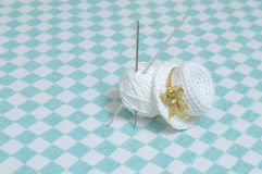 Knitted hat, crochet hook and ball of yarn Royalty Free Stock Image