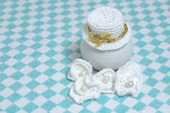 Knitted hat and flowers, decoration elements. For clothing and accessories Stock Photos