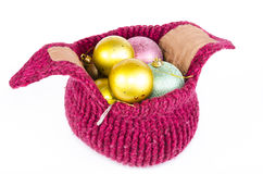 Knitted hat full of christmas balls Royalty Free Stock Images
