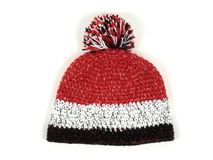 Knitted hat with pompom. On white background Stock Photo