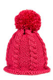 Knitted hat with a pompon. Isolated on white background stock images