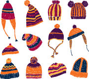 Knitted hats. Vector image of a set of the warm knitted hats stock illustration