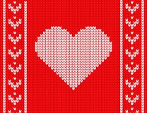 Knitted heart on a red background. cozy sweater. vector illustration