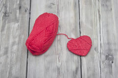 Knitted heart and red of yarn Royalty Free Stock Photography