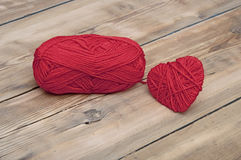Knitted heart and red of yarn Royalty Free Stock Image