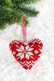 Knitted heart on the snow Royalty Free Stock Images