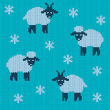 Knitted holiday seamless. Pattern for the New Year 2015 with snowflakes, lamb and goat on a blue background Vector Illustration