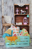 Knitted home decorations in wooden box Royalty Free Stock Images