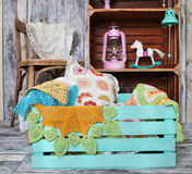 Knitted home decorations in wooden box Royalty Free Stock Image