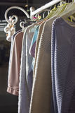 Knitted homemade clothes of different colors hanging on a hanger Royalty Free Stock Image