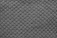 Knitted honeycomb texture of black color Stock Image