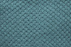 Knitted honeycomb texture of blue green color Stock Images