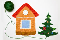 Knitted house and christmas tree on white. Amusing knitted house and christmas tree against white Royalty Free Stock Photos