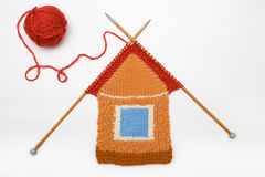 Knitted house on white background Stock Images