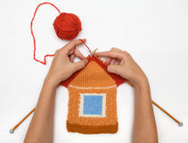 Knitted house on white background. The amusing knitted house  against white Royalty Free Stock Photo