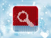 Knitted icon with a search Stock Photos