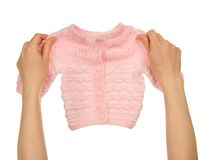 Knitted jacket in the female hands Royalty Free Stock Image