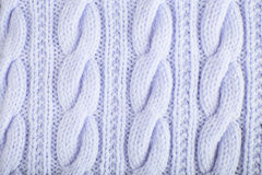 Knitted jersey background with a relief pattern Royalty Free Stock Images