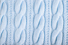 Knitted jersey background with a relief pattern Royalty Free Stock Photos