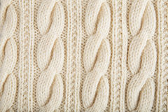 Knitted jersey background with a relief pattern Stock Photo