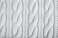 Knitted jersey background with a relief pattern Stock Photos