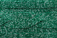 Knitted jersey green background with a relief pattern. High reso Stock Images