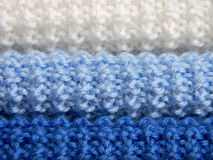 Knitted jersey. Handwork. Use as a background. Knitted jersey. Handwork. Three colors: white, light-blue, blue. Use as a background Stock Photography