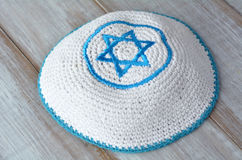 Knitted kippah with embroidered blue and white Star of David Royalty Free Stock Images