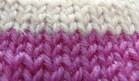 Knitted lilac and white thread product Royalty Free Stock Photos