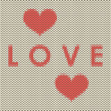 Knitted love covet with red hearts Stock Photography