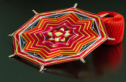 Knitted mandala and thread-ball Royalty Free Stock Images