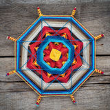 Knitted mandala on wooden plank Royalty Free Stock Image