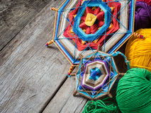 Knitted mandala and yarn on rustic table. Two knitted tibetan mandala from threads and yarn on rustic table Stock Photography