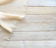 Knitted material and grunge wood board texture background. Surface of aged white wooden planks and shawl texture fabric , top view, empty place Royalty Free Stock Photos