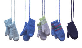 Knitted Mittens. Five pairs of mittens hanging on strings Royalty Free Stock Photo