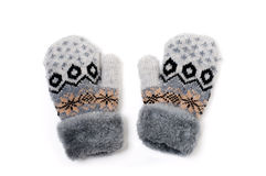 Knitted Mittens. A pair of baby gray gloves with pattern on white background Stock Photos