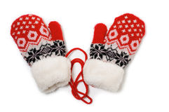 Knitted Mittens. A pair of red baby mittens with pattern on white background Royalty Free Stock Image