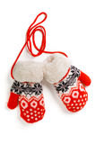 Knitted Mittens. A pair of red baby mittens with pattern on white background Royalty Free Stock Photography