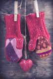 Knitted mittens winter background Stock Photos