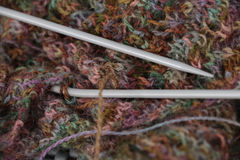 Knitted multicolored yarn wool pattern with knitting needles Stock Photos