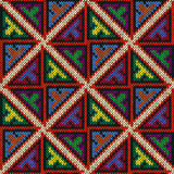 Knitted multicolour geometric seamless motley pattern Royalty Free Stock Image