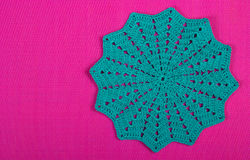 Knitted napkin on pink background. Knitted texture. Stock Image