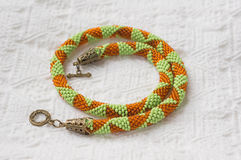 Knitted necklace from beads with geometrical drawing Royalty Free Stock Photography