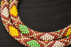 Knitted necklace from beads with a geometrical pattern Royalty Free Stock Images