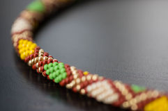 Knitted necklace from beads with a geometrical pattern Stock Image