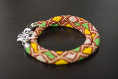 Knitted necklace with a pattern in the form of rhombuses Royalty Free Stock Photo